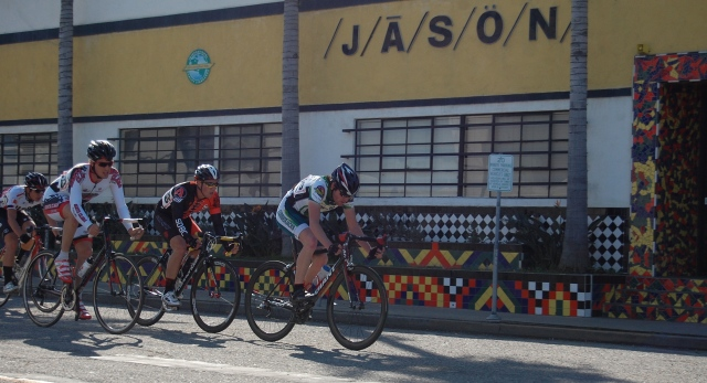 Jason drills it at the front of the breakaway as he passes his namesake building.