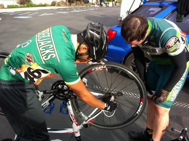 Zach helps fix Gilbert's bike.